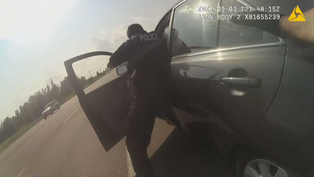 Bodycam Video Shows Harrah Officer Being Dragged By Vehicle Of Suspect