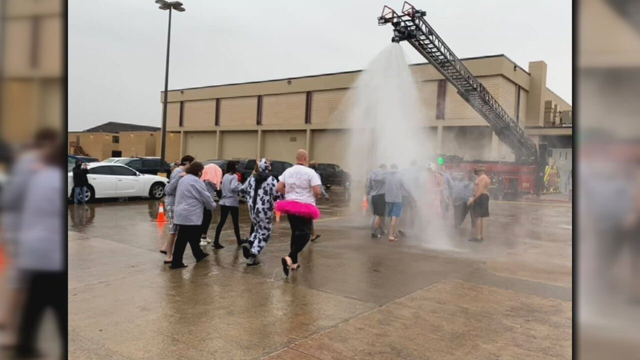Del City Firefighters Help Students Take The Polar Plunge To Raise Money