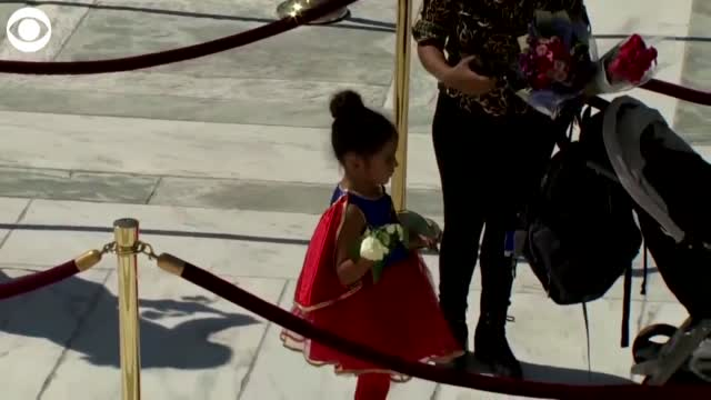 WATCH: Little Girl Dresses As Supergirl To Pay Respects To Justice Ginsburg
