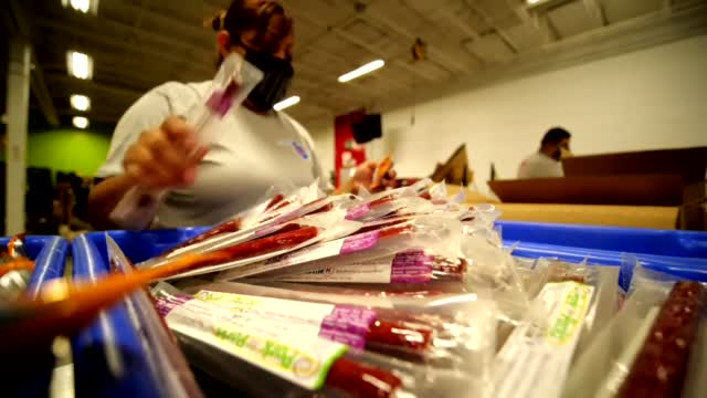 Oil Company Donates Workers To Volunteer For Regional Food Bank