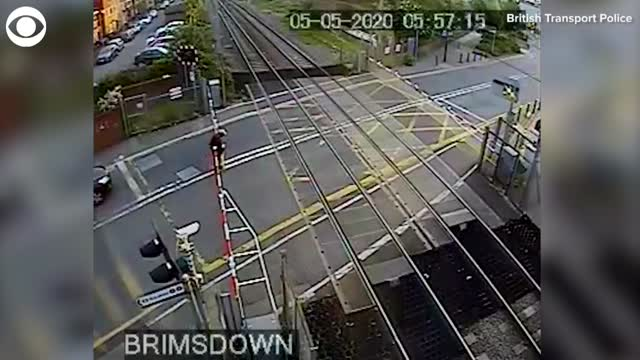 WATCH: Train Narrowly Misses Man Who Forced His Way Through Crossing Gates