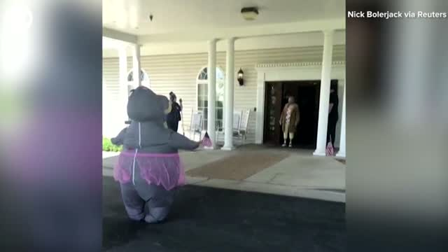 WATCH: A Woman Wears A Hippo Costume To Hug Mom At Nursing Home