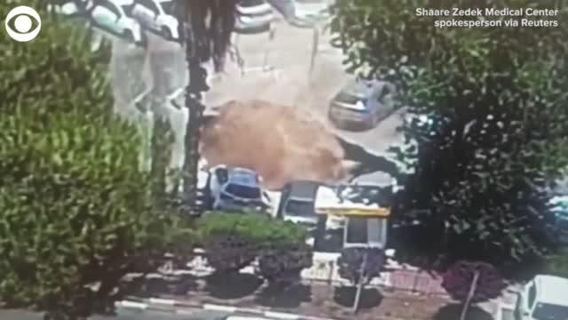 WATCH: Sinkhole Swallows Cars In Hospital Parking Lot