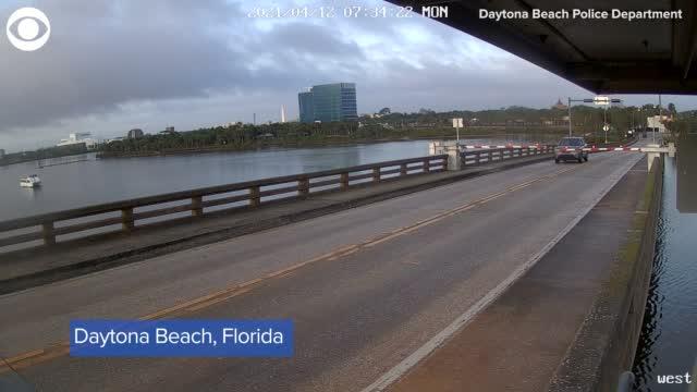 WATCH: Driver Runs Through Traffic Arm, Jumps Bridge In Florida