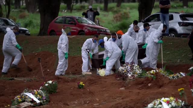 Brazil Digging Graves Around The Clock As It Faces Possible Worst Month Yet Of COVID Crisis