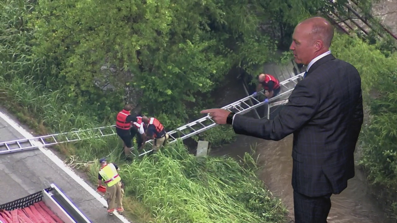 WATCH: Firefighters Rescue Man After SUV Crashes Into Creek