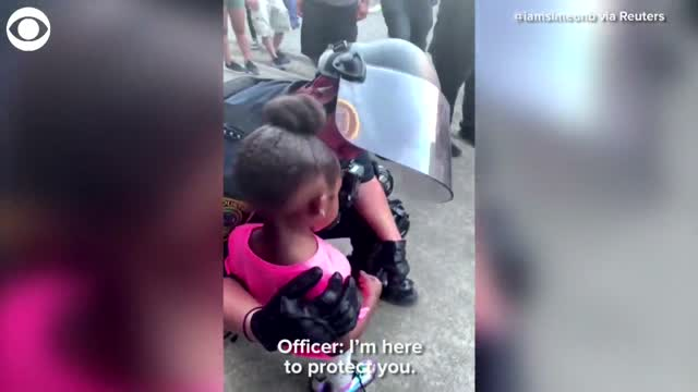 Houston Officer Comforts 5-Year-Old Girl During Protest
