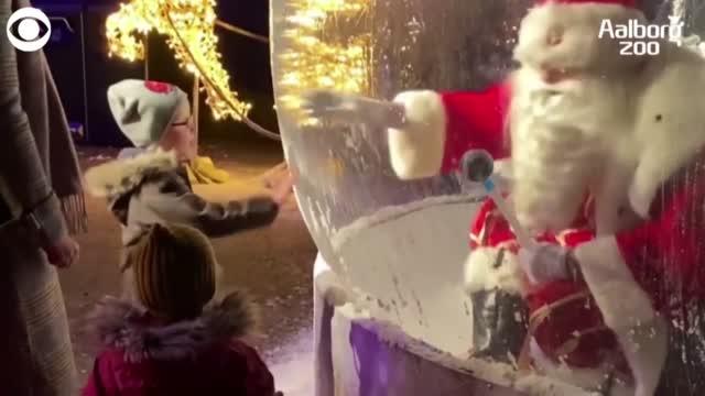 WATCH: Santa Greets Children From Snow Globe