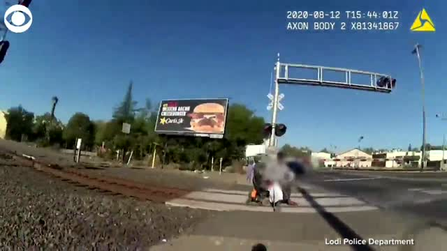 WATCH: Police Officer Saves Man In Wheelchair From Oncoming Train
