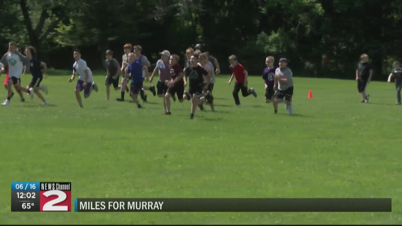 Image for Little Falls students, staff run in memory of late track coach
