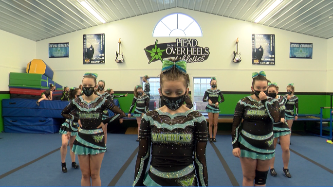 Image for Head Over Heels cheer program picks up national titles