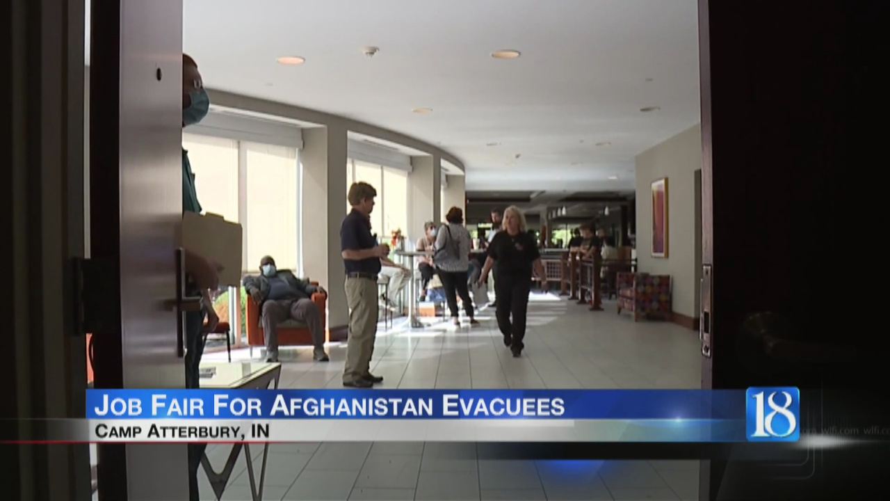 Image for People line up for job fair to help Afghanistan evacuees