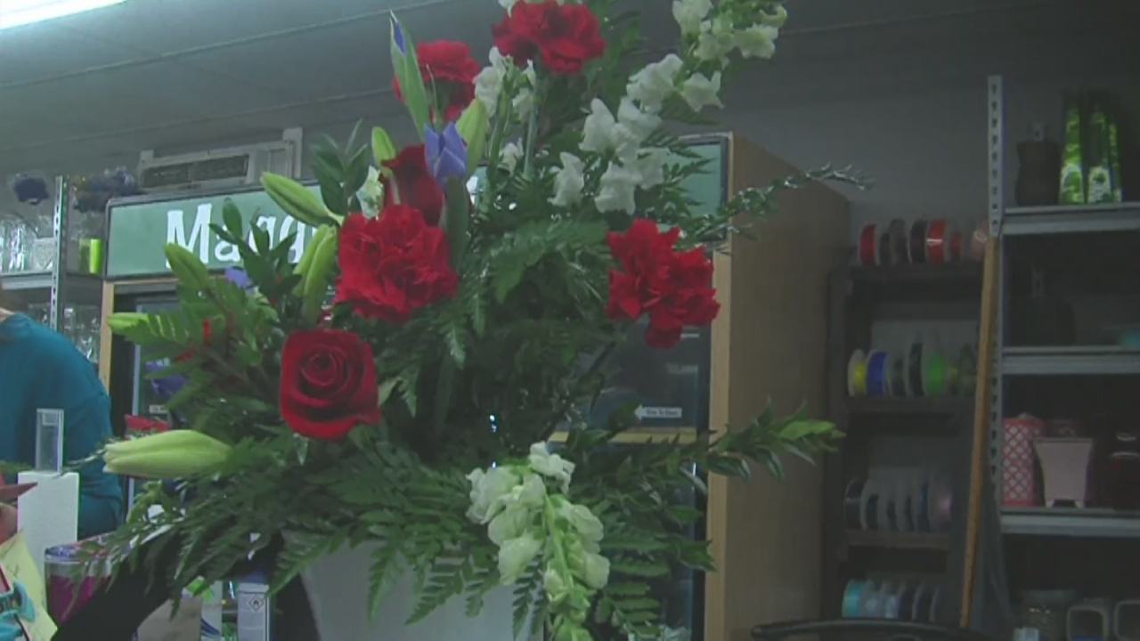 Image for Local flower shop prepares dozens of flowers to honor Detective Ferency